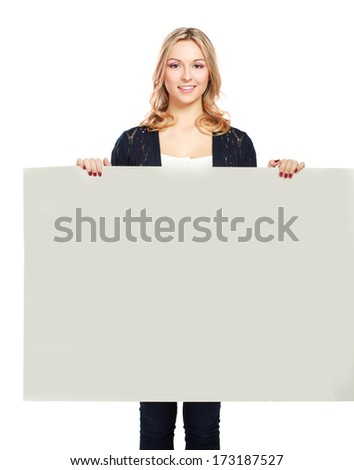 Portrait of a casual young woman holding blank card - on white background - stock photo