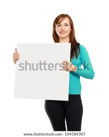 Portrait of a casual young woman holding blank card - over white background. - stock photo