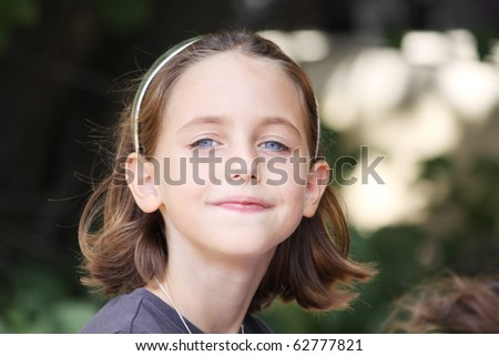 portrait of a caucasian child smiling at the camera - stock photo