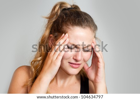 portrait of a caucasian woman with headache - stock photo