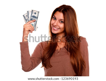 Portrait of a charming and smiling young woman with cash money against white background - stock photo