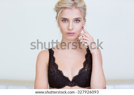 Portrait of a charming girl in lingerie looking at camera isolated on a white background - stock photo