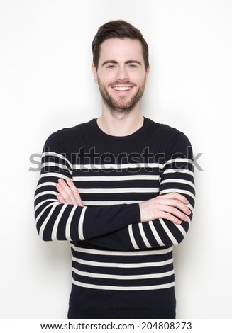 Portrait of a charming young man smiling with arms crossed on white background - stock photo