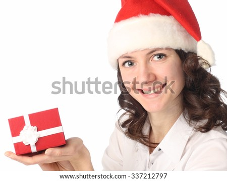 Portrait of a charming young smiling woman holding a present in her hand isolated on white - stock photo