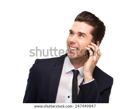 Portrait of a cheerful business man talking on mobile phone - stock photo
