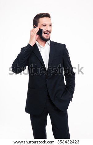 Portrait of a cheerful businessman talking on the phone isolated on a white background - stock photo
