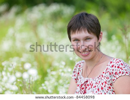 Portrait of a cheerful caucasian on chamomile background - stock photo