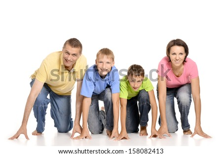 Portrait of a cheerful family of four people having fun on a white background - stock photo