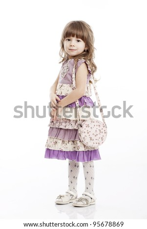 Portrait of a cheerful little girl with a bag - stock photo