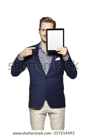 Portrait of a cheerful young businessman pointing at digital tablet. - stock photo