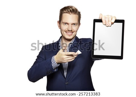 Portrait of a cheerful young man is showing something on digital tablet. - stock photo