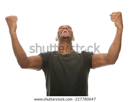 Portrait of a cheerful young man shouting with arms raised in success - stock photo