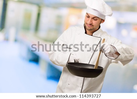 Portrait Of A Chef Preparing Food, Indoors - stock photo