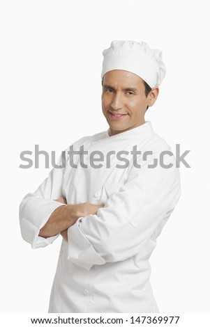 Portrait of a chef standing with arms crossed - stock photo