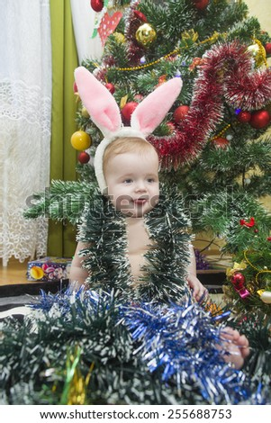 Portrait of a child on a background of Christmas tree - stock photo