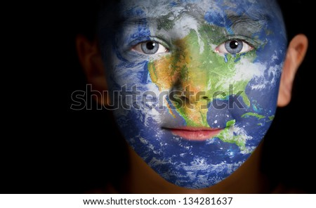 Portrait of a child with a painted North America. Elements of this image furnished by NASA - stock photo