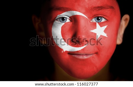 Portrait of a child with a painted  turkish flag, closeup - stock photo