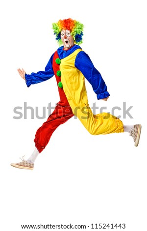 Portrait of a clown jumping over white background - stock photo