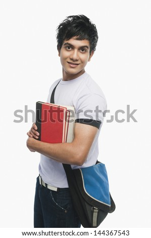 Portrait of a college student holding notebooks - stock photo