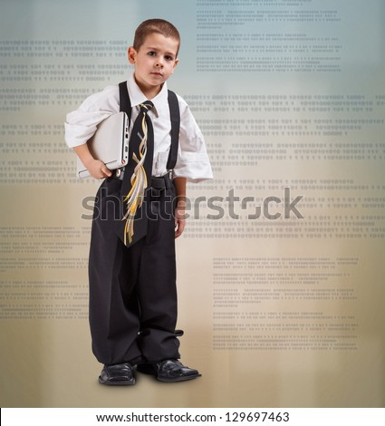 Portrait of a confident business boy standing with laptop - stock photo