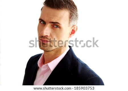 Portrait of a confident businessman isolated on a white background - stock photo