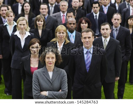 Portrait of a confident businessman with multiethnic team - stock photo