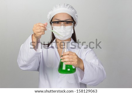 Portrait of a confident female professional in his working in chemical laboratory - stock photo