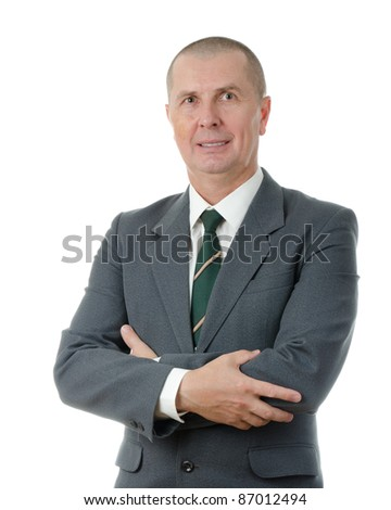 Portrait of a confident male entrepreneur standing with folded hand isolated on white background - stock photo