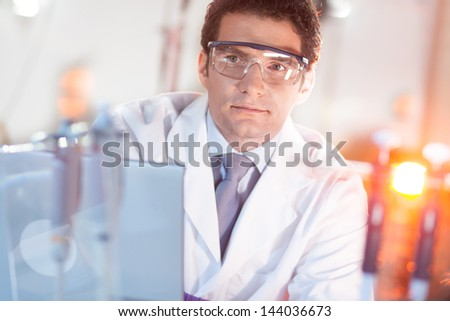 Portrait of a confident nano technology technician in his working environment. - stock photo