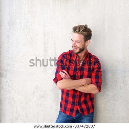Portrait of a confident smiling man posing with arms crossed  - stock photo