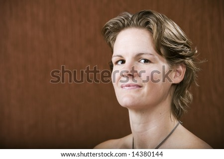 Portrait of a confident woman in a studio setting - stock photo