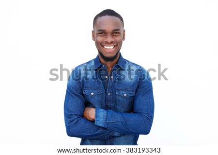 Portrait of a confident young african guy smiling with arms crossed against white background   - stock photo