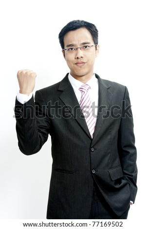 Portrait of a confident young male entrepreneur ready for fight against grey background - stock photo