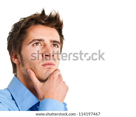 Portrait of a confident young man looking up - stock photo