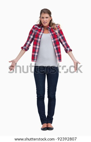 Portrait of a confused woman against a white background - stock photo
