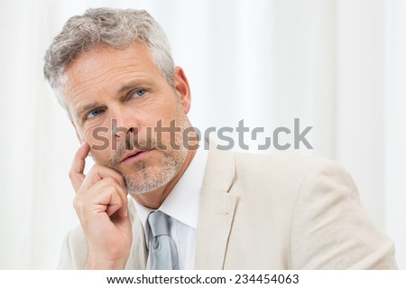 Portrait Of A Contemplative Business Man At Office - stock photo