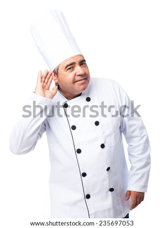 portrait of a cook man trying to listen to something - stock photo