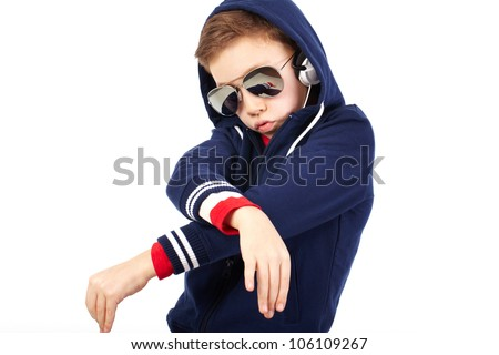 Portrait of a cool kid dressed like a rapper - stock photo