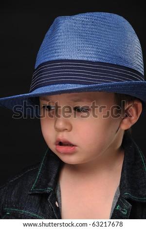 Portrait of a cool little boy in a fancy hat - stock photo