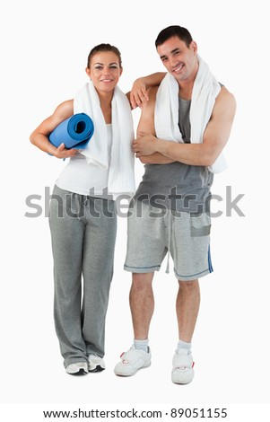 Portrait of a couple going to practice yoga against a white background - stock photo