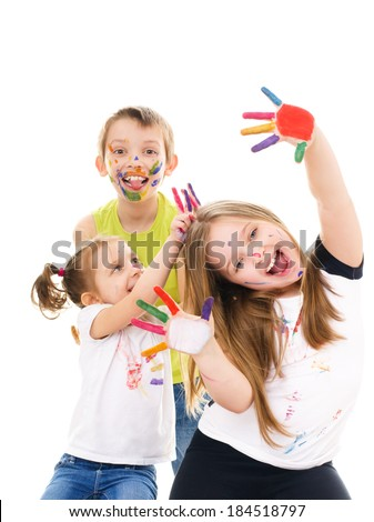 Portrait of a couple happy children showing their hands painted in bright colors, isolated over white - stock photo
