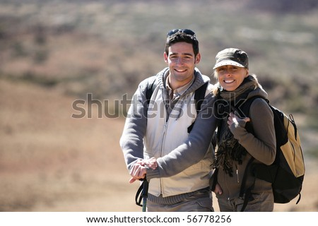 Portrait of a couple of hikers smiling - stock photo