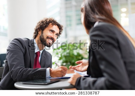 Portrait of a couple of  working business people - stock photo