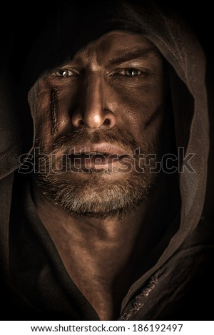 Portrait of a courageous warrior wanderer in a black cloak. Historical fantasy. Halloween. - stock photo