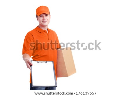 Portrait of a courier in orange uniform with a box and tablet - stock photo