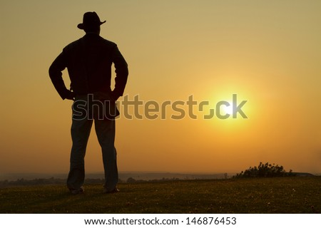 Portrait of a Cowboy Gazing into the sunset - stock photo