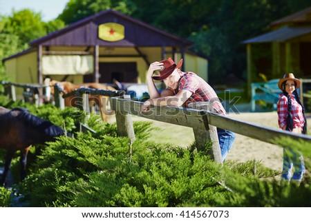 Portrait of a cowboy on the farm - stock photo