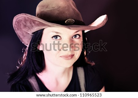 portrait of a cowgirl in a hat - stock photo