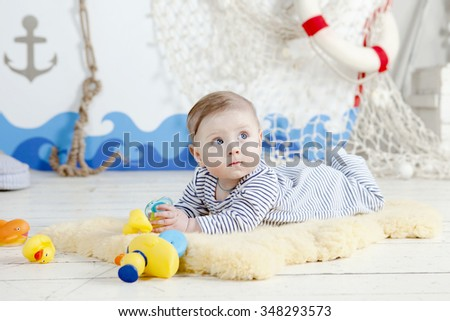 Portrait of a crawling baby  - stock photo