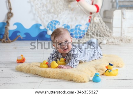 Portrait of a crawling baby boy - stock photo